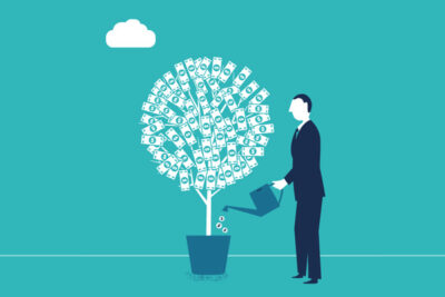 Man watering a tree with coins